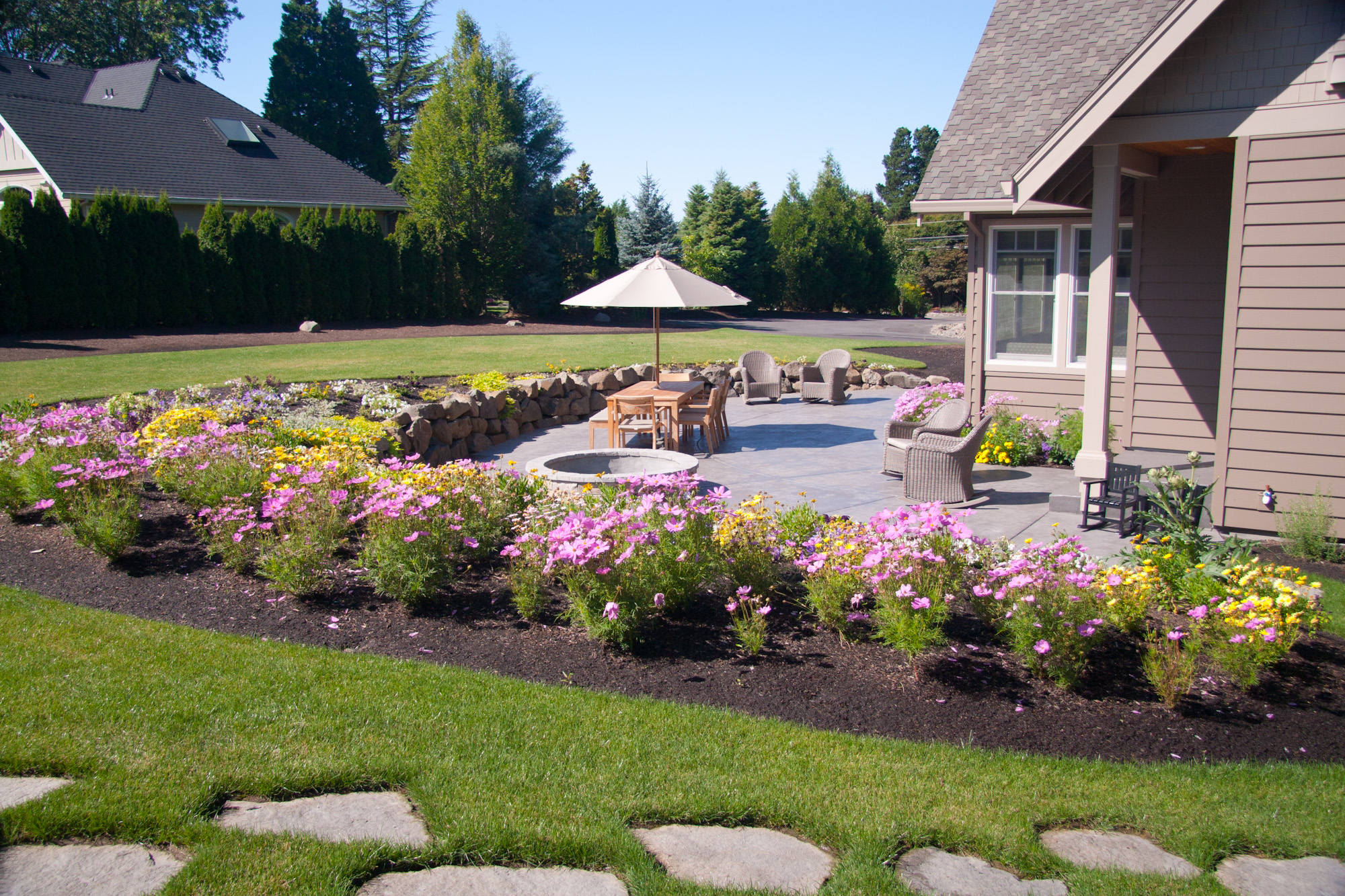 Landcsape design before and after pictures portland oregon for Flowers landscape gardening